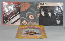THE BEATLES - A GROUP OF FOUR VINYL RECORD ALBUMS