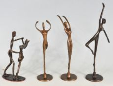 FOUR BRASS DANCING STATUES