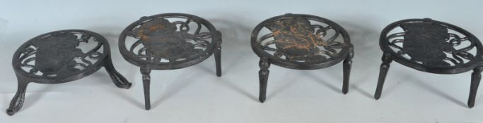 FOUR ANTIQUE STYLE CAST IRON TRIVETS