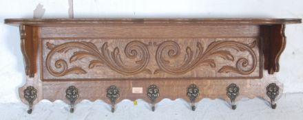 20TH CENTURY OAK CARVED WALL MOUNTED COAT RACK