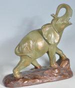 VINTAGE CHALKWARE ELEPHANT FIGURINE
