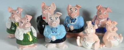 EIGHT WADE NAT WEST CERAMIC PIGS