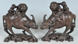 TWO CHINESE ORIENTAL HARDWOOD LUCKY WATER BUFFALOS