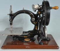 19TH CENTURY VICTORIAN WILCOX AND GIBBS HAND OPERATED CAST IRON SEWING MACHINE