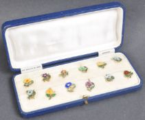 CASED SET OF 1920S STERLING SILVER & ENAMEL CUP TOKENS