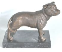20TH CENTURY CAST BRONSE FIGURE OF A STAFFORDSHIRE TERRIER DOG.