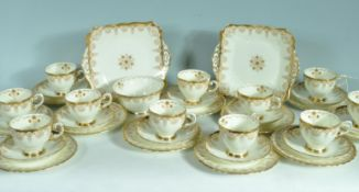 11 PERSON TEA SET BY TUSCAN CHINA IN PLANT PATTERN