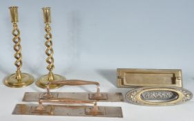 COLLECTION OF 20TH CENTURY BRASSWARE TO INCLUDE CANDLESTICKS AND DOOR HANDLES.