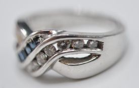 STAMPED 14CT WHITE GOLD CROSSOVER RING