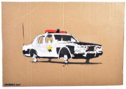 BANKSY - DISMALAND 2015 - COP CAR