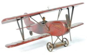 20TH CENTURY RUSTIC HAND PAINTED MODEL OF A BIPLANE