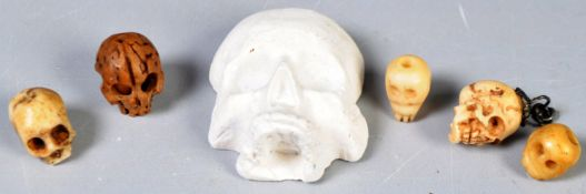 GROUP OF 19TH CENTURY MINIATURE CARVED SKULLS