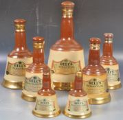COLLECTION OF BELLS CERAMIC WHISKY DECANTERS