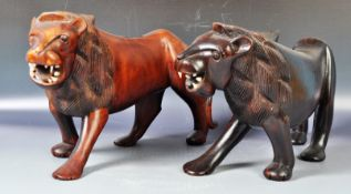LARGE CARVED PAIR OF ART DECO INFLUENCE AFRICAN HARDWOOD LIONS