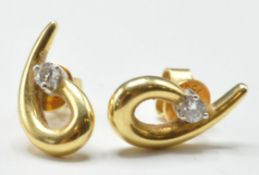 PAIR OF 18CT GOLD AND DIAMOND STUD EARRINGS