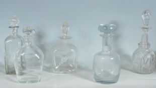 FIVE 18TH AND 19TH CENTURY GEORGIAN DECANTERS