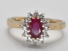 9CT GOLD RED STONE AND DIAMOND RING