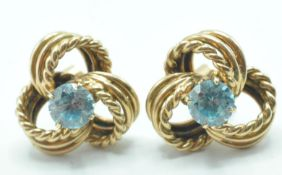 9CT GOLD AND BLUE STONE KNOT EARRINGS