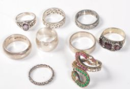 EIGHT SILVER 925 RINGS
