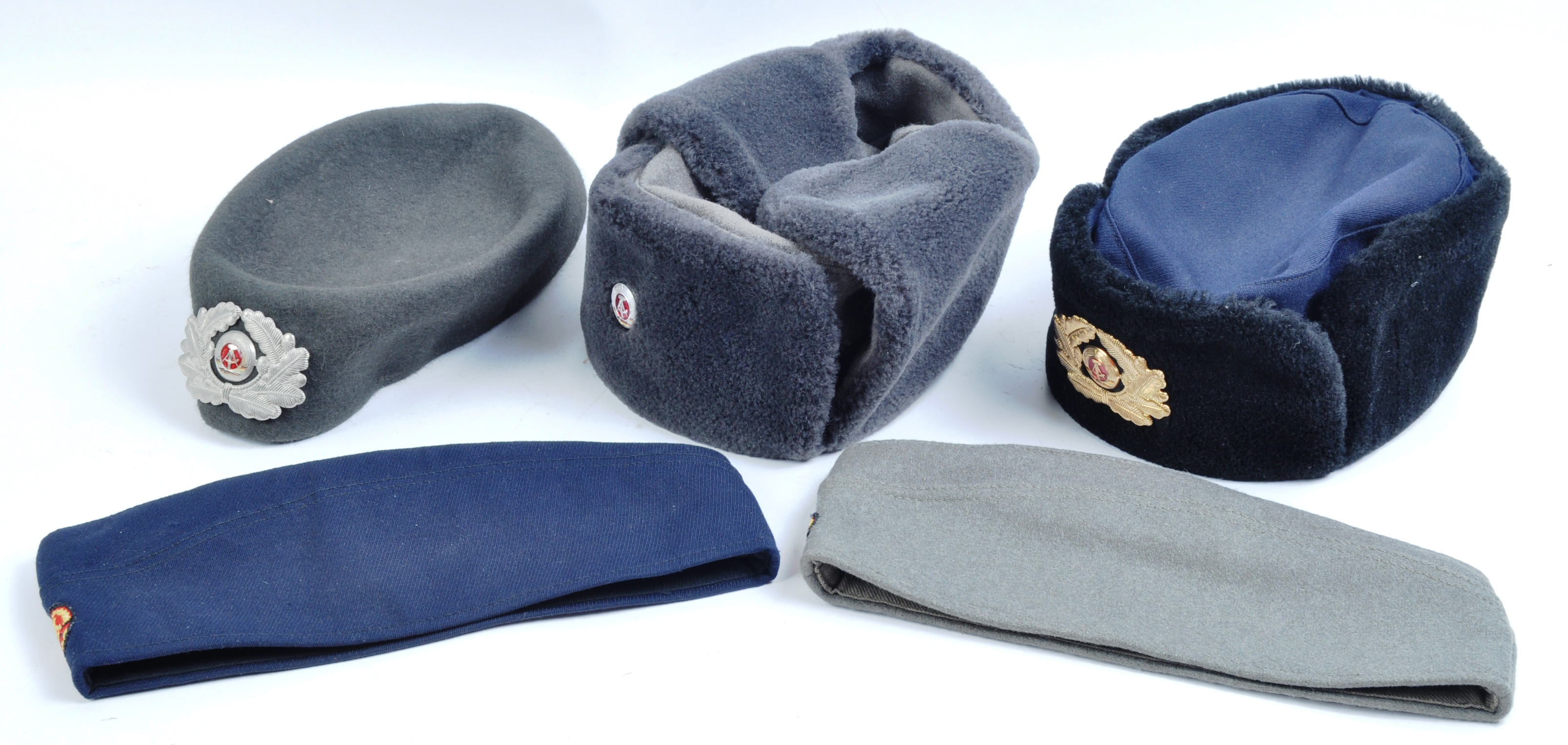 COLLECTION ASSORTED EAST GERMAN NATIONAL PEOPLE'S ARMY HATS