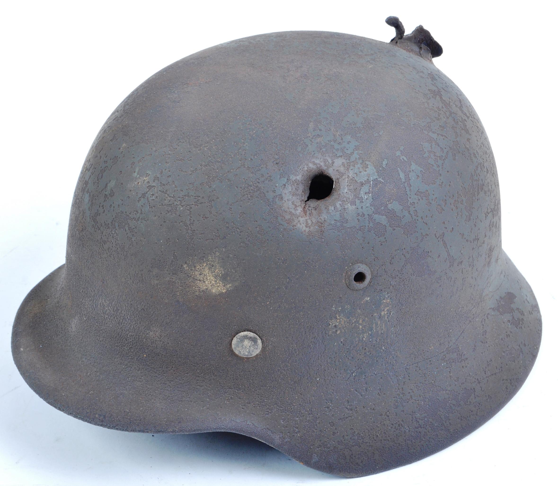 ORIGINAL WWII GERMAN M35 STAHLHELM BATTLE DAMAGED HELMET
