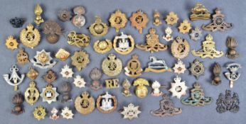 COLLECTION OF ASSORTED WWII AND WWII MILITARY CAP BADGES