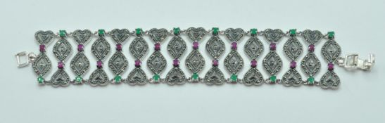STAMPED 925 SILVER CUFF BRACELET SET WITH MARCASITES AND PINK STONES.