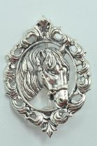 STAMPED STERLING SILVER HORSE BROOCH.