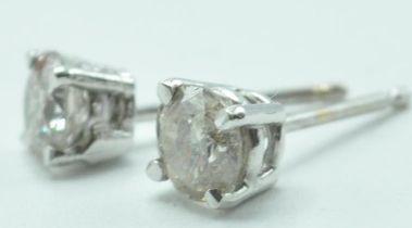 PAIR OF 14CT WHITE GOLD DIAMOND STUD EARRINGS.