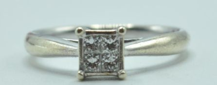 STAMPED 9CT WHITE GOLD AND DIAMOND RING.