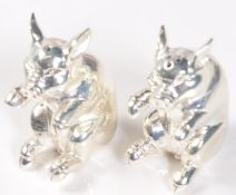 PAIR OF SILVER PLATED CONDIMENT SALT AND PEPPER SHAKERS IN THE FORM OF PIGS.