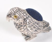 STAMPED STERLING SILVER PARROT PIN CUSHION.