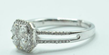 STAMPED 18K WHITE GOLD AND DIAMOND CLUSTER RING.