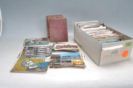 A SHOE BOX OF VINTAGE POSTCARDS