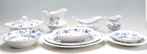 BLUE AND WHITE DINNER SERVICE BY J & G MEAKIN IN BLUE NORDIC PATTERN
