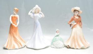 COLLECTION OF FOUR CERAMIC FIGURINES