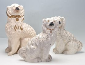 THREE 19TH CENTURY VICTORIAN STAFFORDSHIRE SPANIEL DOGS