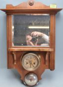 CIRCA 1920'S - 1930'S BEVELLED WALL HANGING MIRROR WITH GERMAN ALARM CLOCK