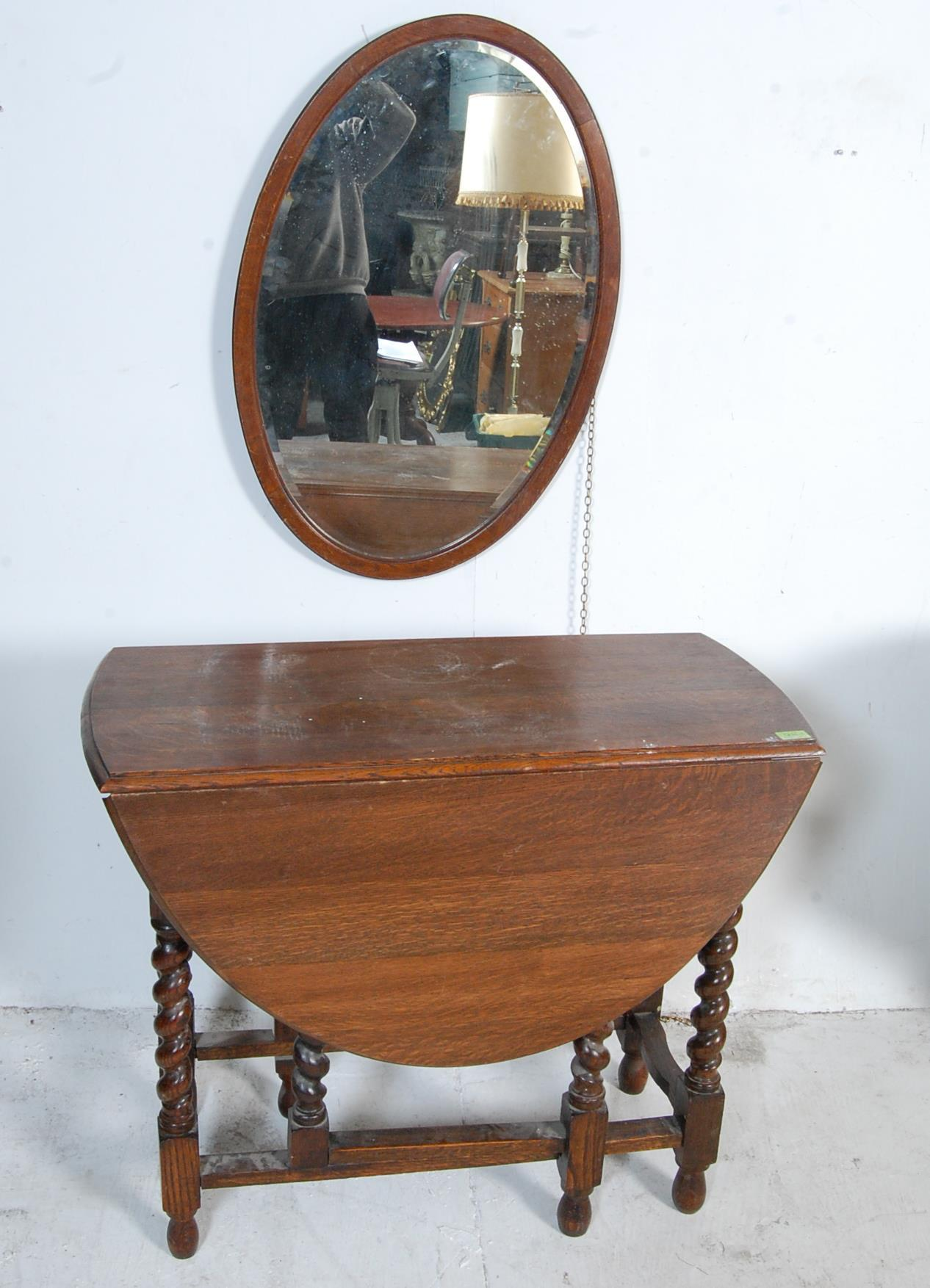 1940'S OAK DROP LEAF DINING TABLE AND OVAL WALL MIRROR