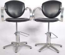 REM - MATCHING PAIR OF ADJUSTABLE BARBER'S ARMCHAIRS