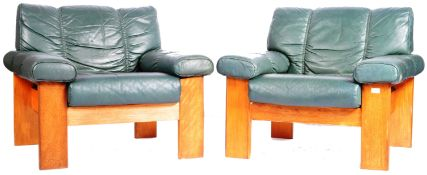 EKORNES - MATCHING PAIR OF TEAK AND LEATHER ARMCHAIRS