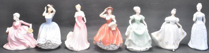 GROUP OF SEVEN CERAMIC PORCELAIN LADIES FIGURINES