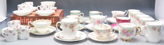COLLECTION OF VINTAGE TEA CUPS AND SAUCERS.