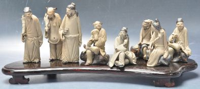 20TH CENTURY CHINESE FIGURAL GROUP OF 8 DAOIST IMMORTALS