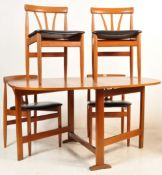 FOUR TEAK WOOD FRAME DANISH INSPIRED DINING CHAIRS AND A DROP LEAF DINING TABLE