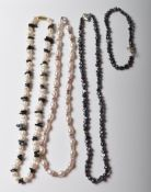 THREE PEARL NECKLACES AND A MATCHING BRACELET.