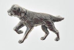 STAMPED STERLING SILVER DOG BROOCH.