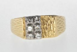 18CT GOLD RING SET WITH SIX DIAMONDS.