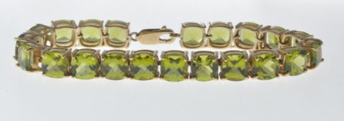 9CT GOLD AND PERIDOT LINE BRACELET