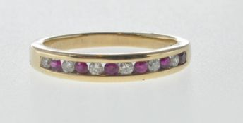 9CT GOLD HALF ETERNITY RING SET WITH WHITE AND RED STONES